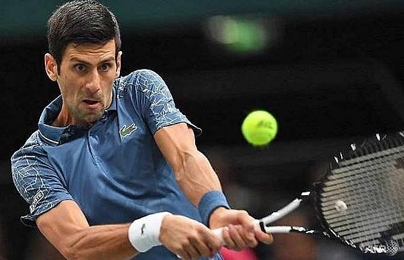 djokovic federer reach paris masters quarter finals