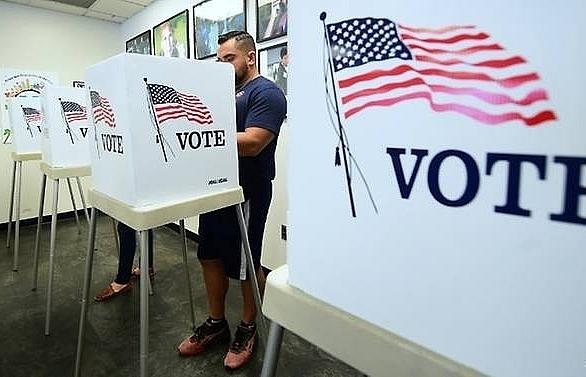 americans start voting in mid term verdict on trump rule