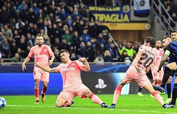 barcelona through to champions league last 16 after inter draw