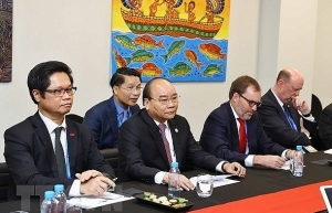 pm phuc receives us enterprises on sidelines of apec summit