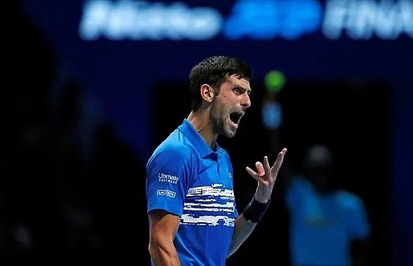 djokovic romps to victory in atp finals opener