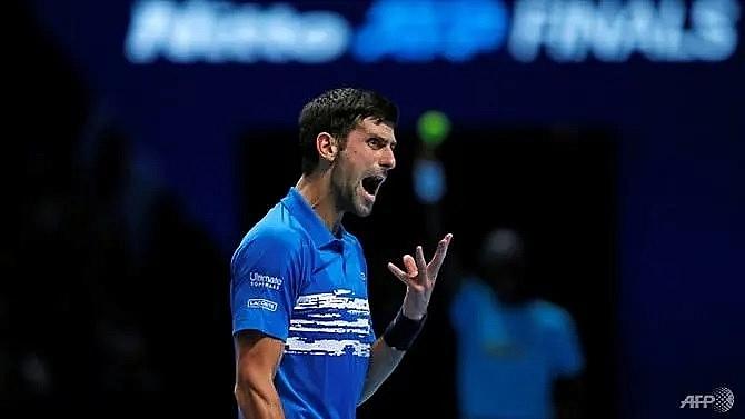 djokovic romps to victory in atp finals opener