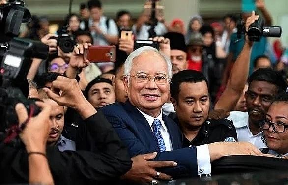 malaysian court rules former prime minister najib razaks 1mdb trial will proceed