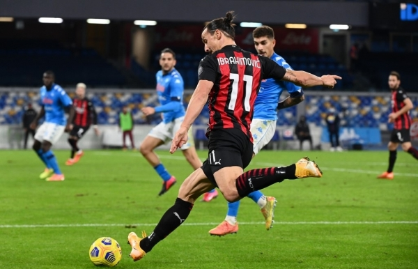 ibrahimovic scores twice limps off as ac milan stay top in serie a