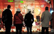People look at toys in the window of a shop in Strasbourg, eastern France. Europeans are tightening their belts and spending less on Christmas gifts this year as they struggle with incomes hit by austerity measures or fear the economy could worsen in 2012.