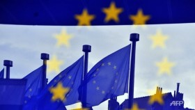 EU backs new sanctions as summit weighs Russia crisis