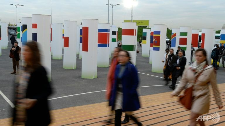 Climate talks must step up pace, says host France