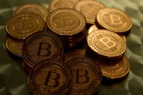 Bitcoin rises in debut as SEC warns on digital money