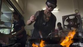 Thai street food cook feels heat of Michelin fame