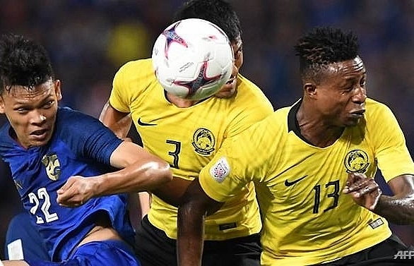 malaysia into suzuki cup final after nailbiting draw