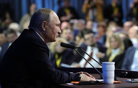 putin says west trying to hold back powerful russia