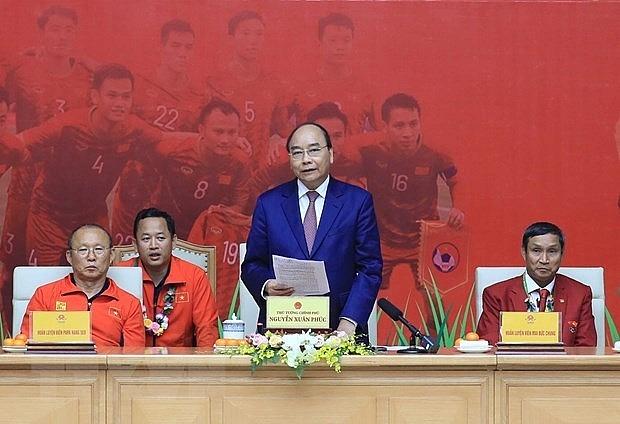 pm praises success of mens and womens football teams at sea games