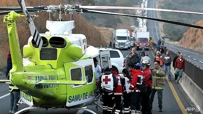 14 killed in fiery family mini bus crash in mexico