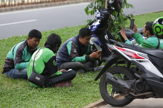 indonesia keeps close watch on gojek grab merger for fear of monopoly