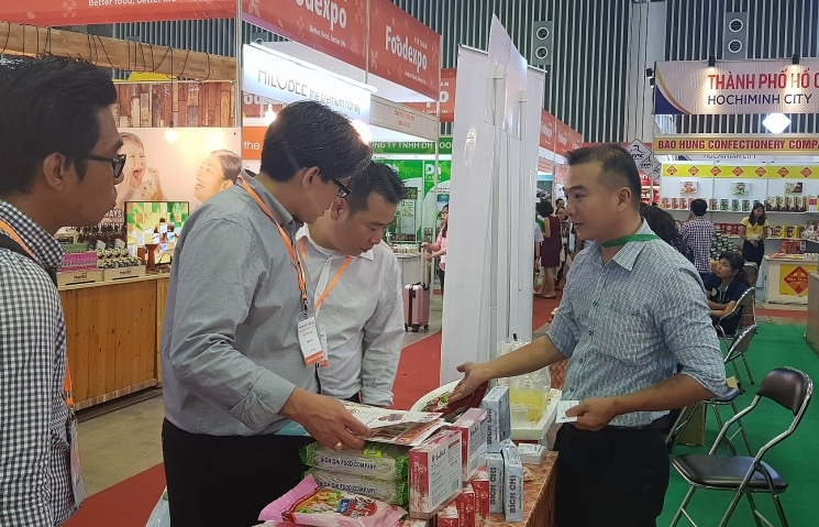 450 foreign and local firms set up booths at vietnam foodexpo 2018