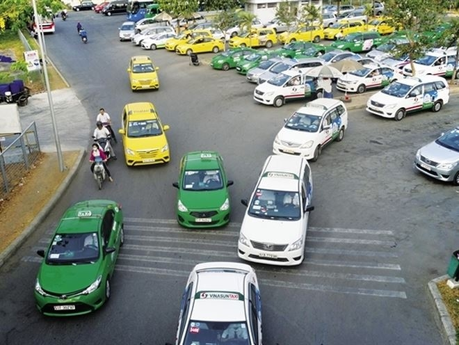 putting ride hailing and taxi firms under same hat could blunt growth