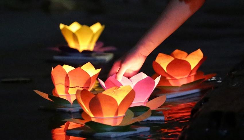lanterns shine on saigon river full moon festival