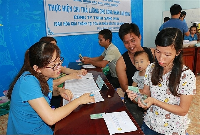 binh phuocs labourers receive owed wages after lawsuit