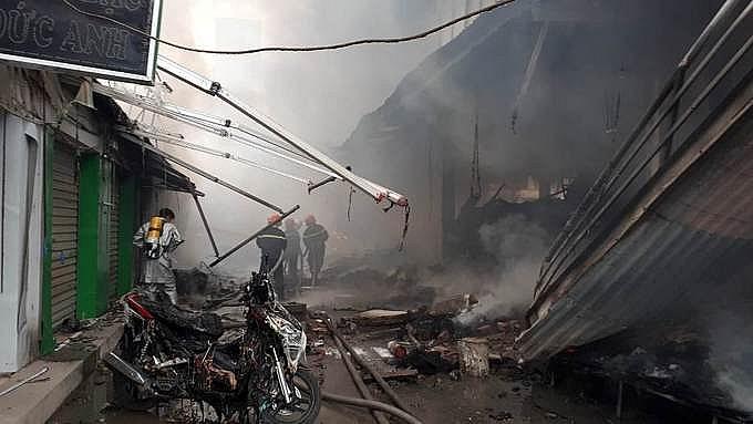 dozens of groceries in hanoi market were burned down