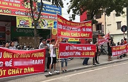 hanoi residents demonstrate against poor fire readiness