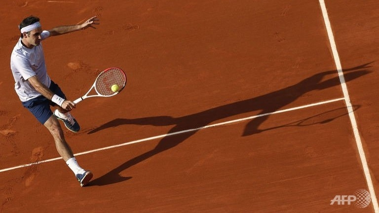 Switzerland's Roger Federer hits a shot to India's Somdev Devvarman during their French Tennis Open match  at the Roland Garros stadium in Paris. (AFP/Thomas Coex)