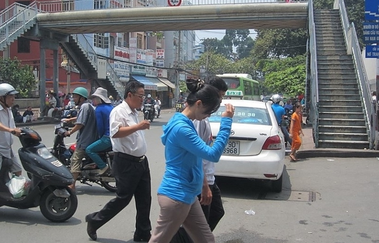 Grab encourages people to use pedestrian overpasses