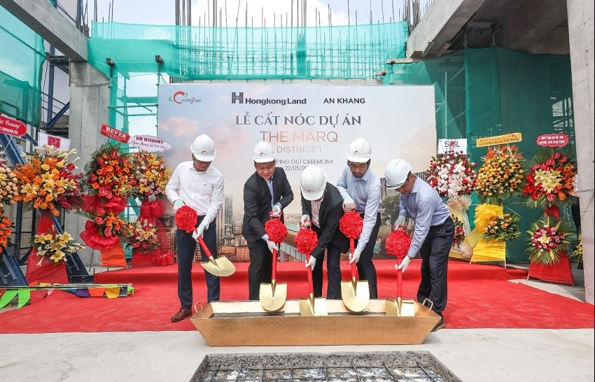 The Marq celebrating its topping-out ceremony
