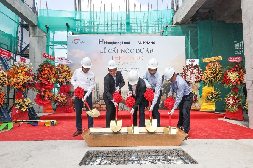 the marq celebrating its topping out ceremony