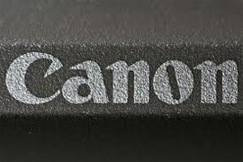 Canon thrives thanks to printers
