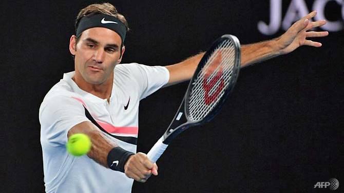 Federer shines as Djokovic survives brutal heat test