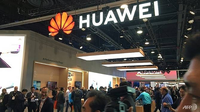us in criminal probe of chinas huawei report