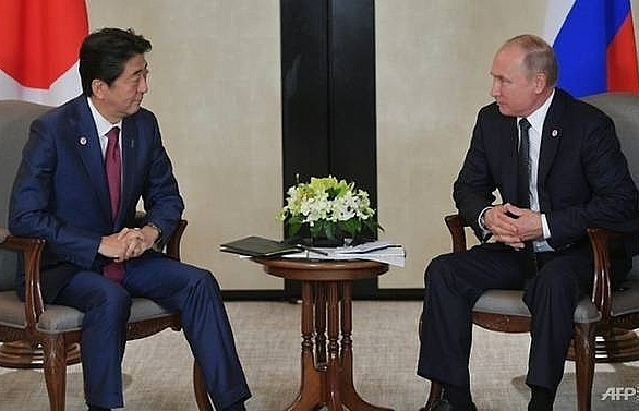 putin abe hold summit to break island impasse