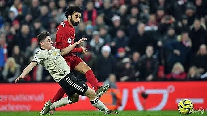 liverpool power past man utd go 16 points clear
