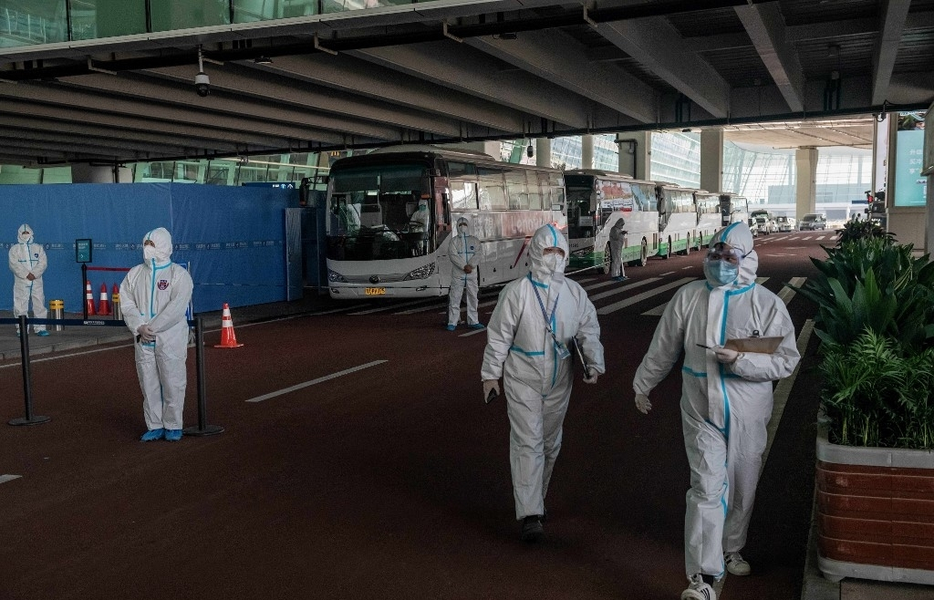 WHO team arrives in Wuhan as China reports first virus death in months