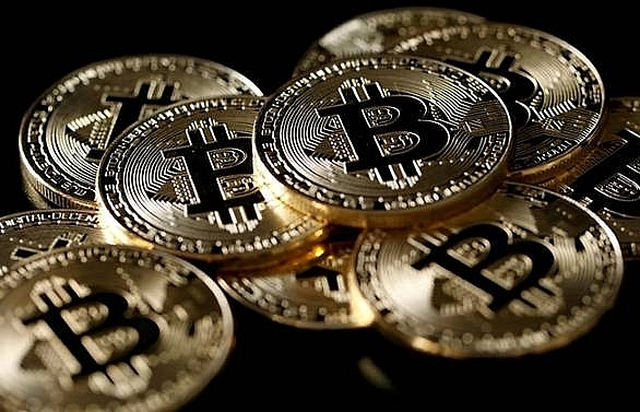 Bitcoin bounces back from three-month low in volatile trade