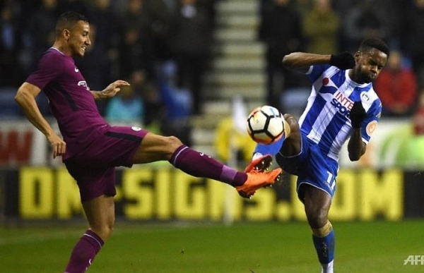 wigan end man city quadruple bid with fa cup shock