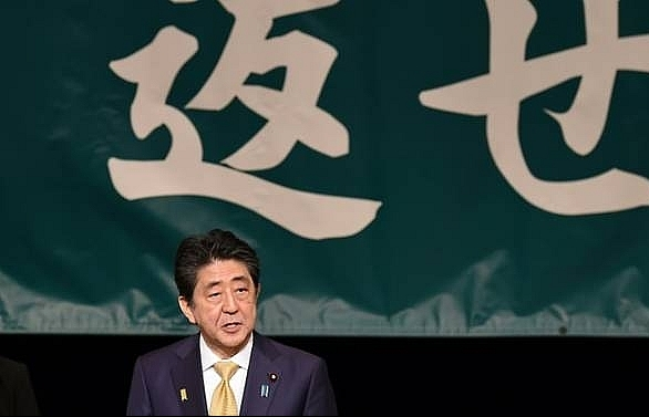 Japan's Abe strikes dovish tone on Russia at Kuril islands rally
