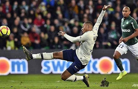 Mbappe fires PSG 12 points clear in France