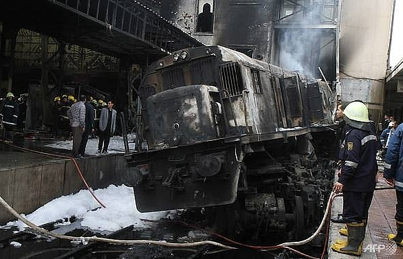 At least 20 killed, 43 injured in crash and fire at Cairo train station