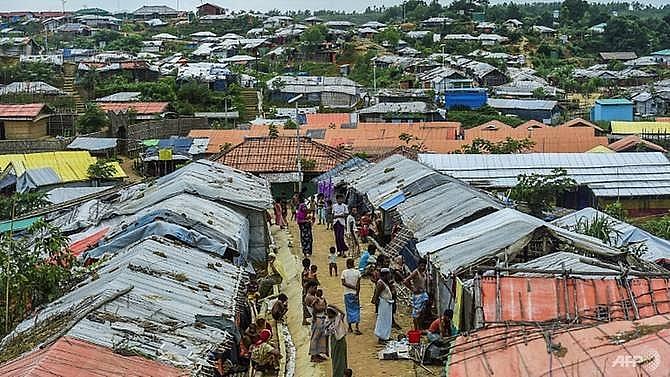 14 rohingya die dozens unaccounted for as boat sinks off bangladesh