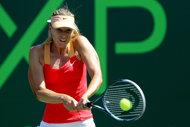 Sharapova beats Wozniacki to reach Miami final