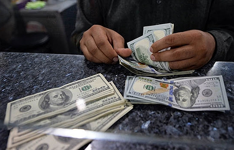 Dollar lower, stock markets 'tepid' before Fed