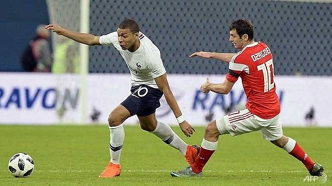 Mbappe shines as France cruise past Russia