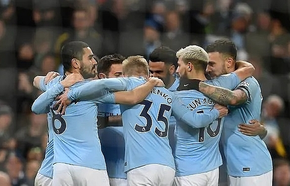Sterling hat-trick takes City four clear
