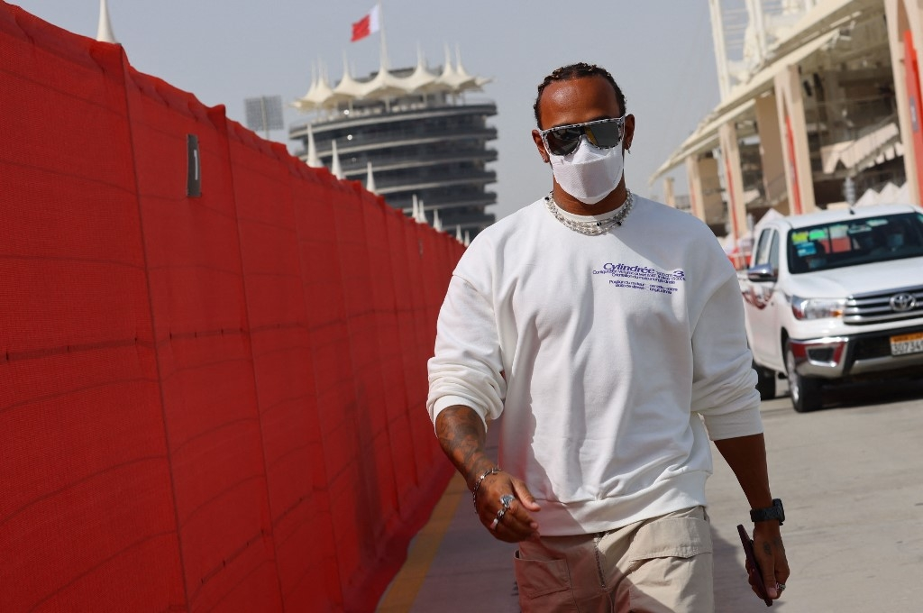 hamilton educates himself as bahrain gp under fire over alleged rights abuses