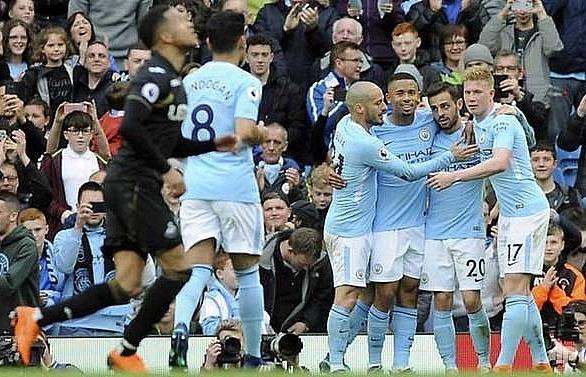 Record seekers Man City thrash Swansea to celebrate title