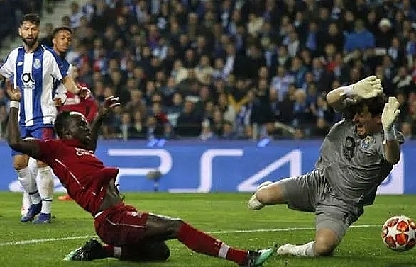 Liverpool seal semi-final date with Barcelona after strolling past Porto
