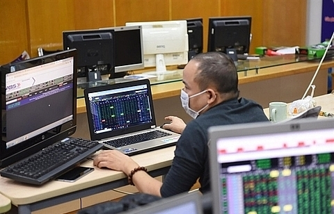 Shares mixed on investor caution