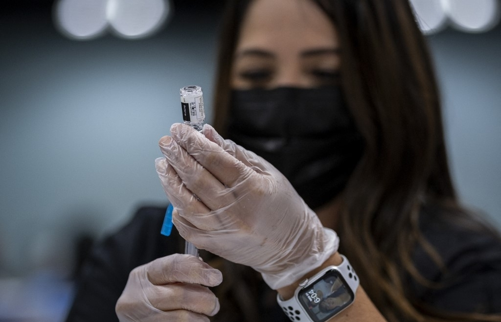 WTO says 2021 global trade recovery rests on vaccines
