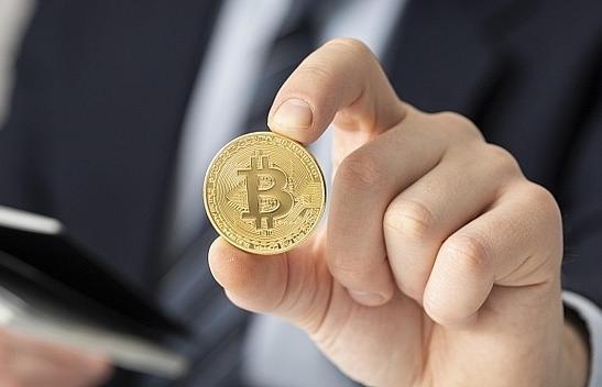 Bitcoin hits record high above $62,000